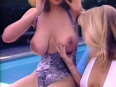 christy canyon &; rikki blake at the pool.
