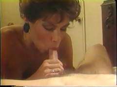 older blonde sucks on a large white pecker in her